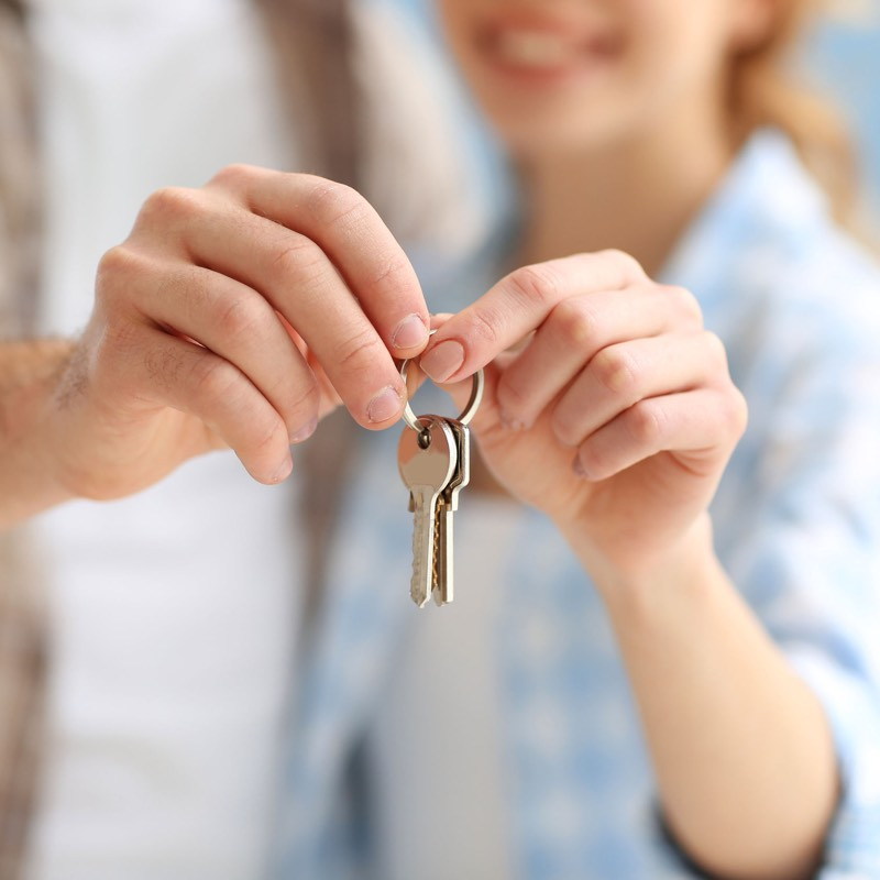 Young couple with keys to their new home